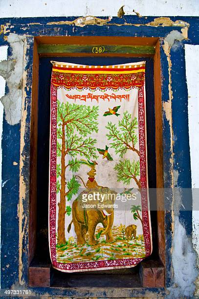 A silk wall hanging featuring an Asian Elephant forms a makeshift door to a Buddhist monk's bedroom.