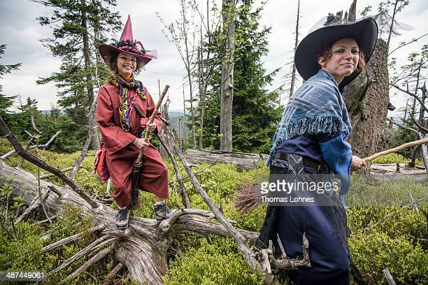 Silke and Lara pose dressed as witches near the mountain Broken on April 30 2014 near Schierke Germany Both Silke and Lara are taking part in the...