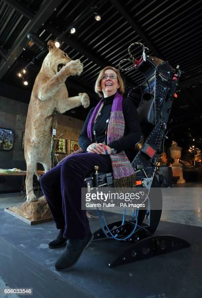 Silke Lohmann of Summers Place Auctions sits in an French ejector seat dated 1978 next to a full mounted leaping Lioness during a press preview of...