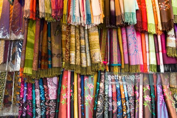 Silks and fabrics in Silk Street,  Old Quarter.