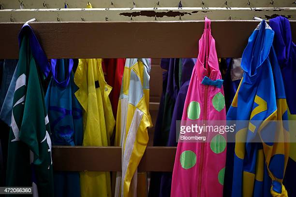 Silks hang from a rack before being distributed in the jockey room at Churchill Downs on the afternoon of the 141st Kentucky Derby in Louisville...
