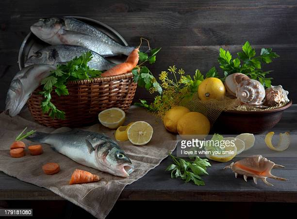 Sill life with fish, lemon and shell