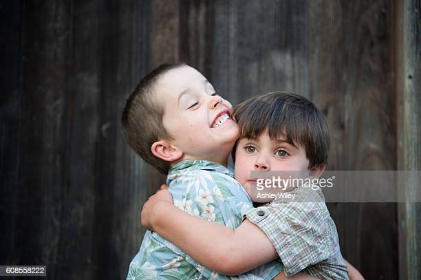 Silly brothers hugging and being funny