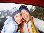 Silly couple laughing in ski lift