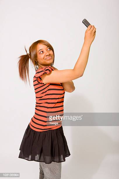 Silly teen girl posing for camera phone
