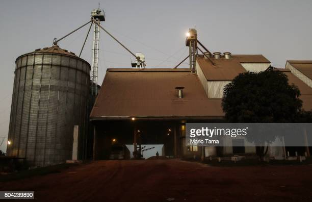 Silos storing cattle feed stand at a cattle feed lot in the Amazon on June 28 2017 near Chupinguaia Rondonia state Brazil The confinement farm...