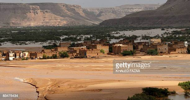 Silt and mud cover the land following two days of storms in the eastern Yemeni province of Hadramaut on October 25 2008 Aid operations swung into...