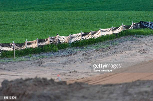 Silt fence with construction berm
