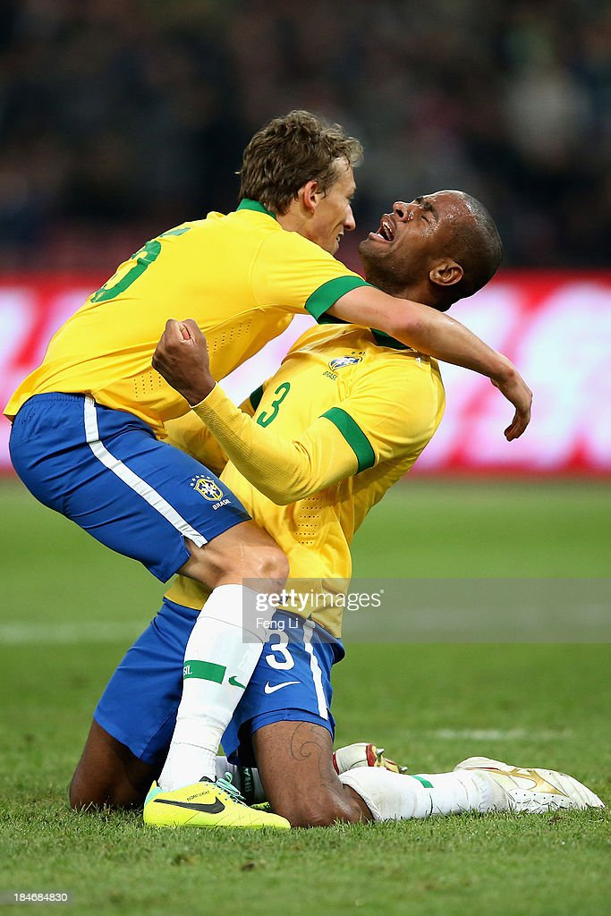 Silva Anderson (R) of Brazil celebrates a goal with his teammate Leiva Lucas (L) during the international friendly match between Brazil and Zambia at Beijing National Stadium on October 15, 2013 in Beijing, China.