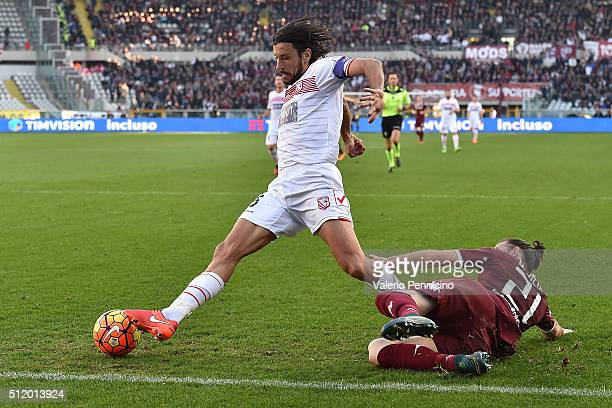 Silva Gaston of Torino FC tackles Cristian Zaccardo of Carpi FC during the Serie A between Torino FC and Carpi FC at Stadio Olimpico di Torino on...