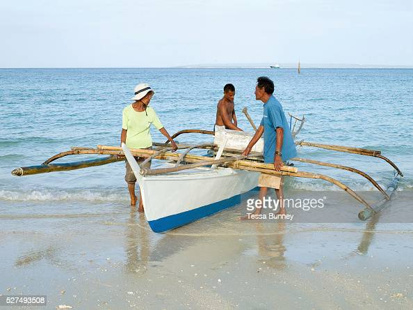 Silvacian Rayco meets her husband Diosdado and son Donato as they return from fishing Talisay Bantayan Island The Philippines On November 6 2013...