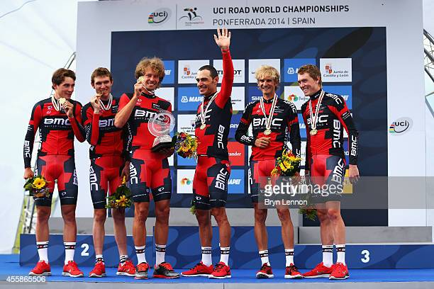 Silvan Dillier Tejay van Garderen Daniel Oss Manuel Quinziato Peter Velits and Rohan Dennis stand on the podium after their victory in the Elite...