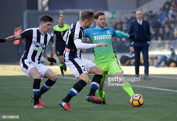 Silvan Widmer and Rodrigo Javier De Paul of Udinese Calcio competes with Cristian Ansaldi of FC Internazionale during the Serie A match between...