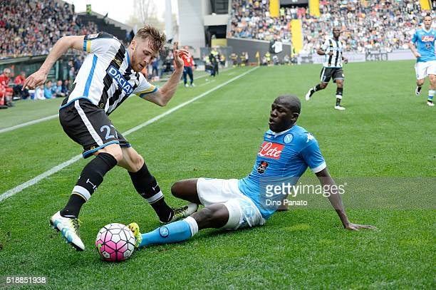 Silvan Widmer of Udinese Calcio battles for the ball with Kalido Koulibaly of SSC Napoli during the Serie A match between Udinese Calcio and SSC...