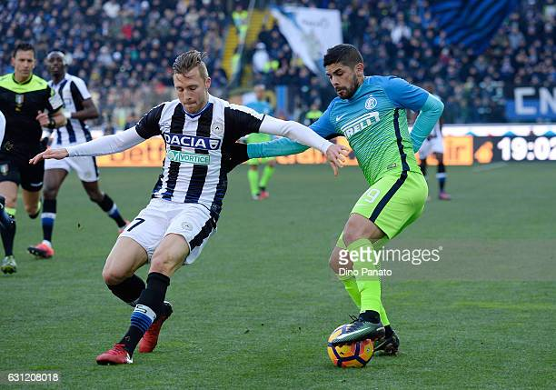 Silvan Widmer of Udinese Calcio competes with Ever Banega of FC Internazionale during the Serie A match between Udinese Calcio and FC Internazionale...