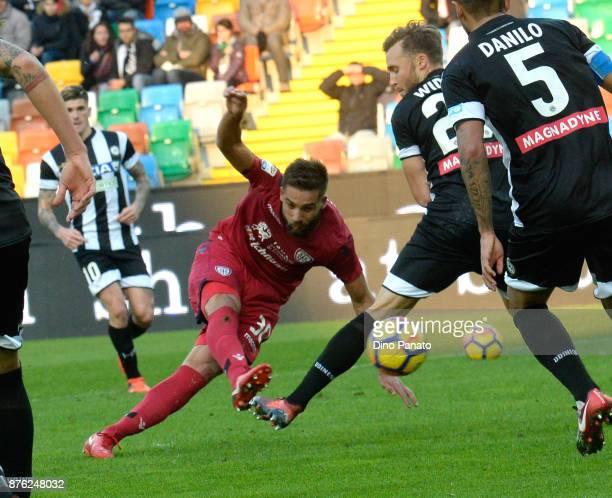 Silvan Widmer of Udinese Calcio competes with Leonardo Pavoletti of Cagliari Calcio during the Serie A match between Udinese Calcio and Cagliari...