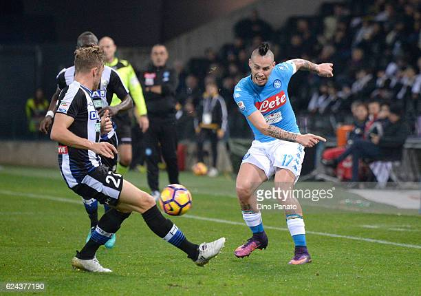 Silvan Widmer of Udinese Calcio competes with Marek Hamsik of SSC Napoli during the Serie A match between Udinese Calcio and SSC Napoli at Stadio...