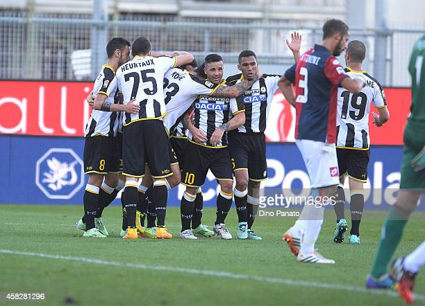 Silvan Widmer of Udinese Calcio is mobbed by team mates after scoring his team's second goal during the Serie A match between Udinese Calcio and...