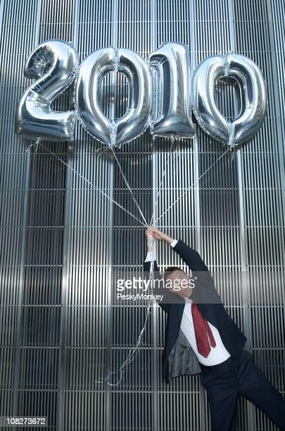 Silver 2010 Balloons Carry Businessman Away