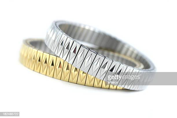 Silver and Gold Bracelets on white