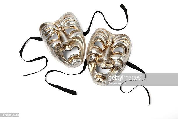 Silver and gold Comedy and Tragedy theater masks on white