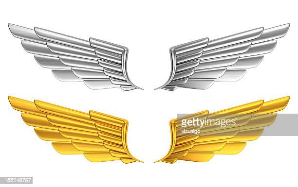 Silver and gold wings against white background