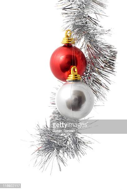 Silver and red ornament hanging from Christmas twine