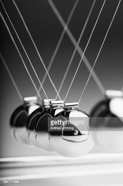 1 silver ball in Newton's cradle swings back toward others