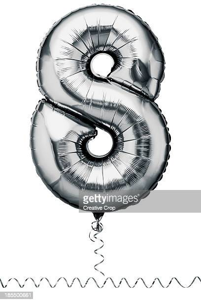 Silver balloon in the shape of a number eight