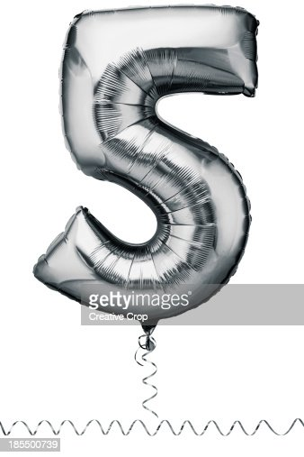 Silver balloon in the shape of a number five