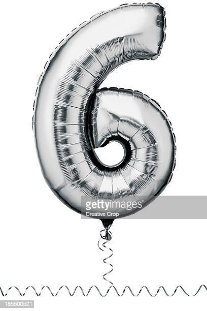 Silver balloon in the shape of a number six