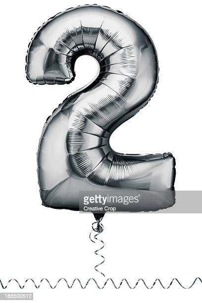 Silver balloon in the shape of a number two