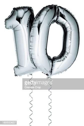 Silver balloons in the shape of a number 10