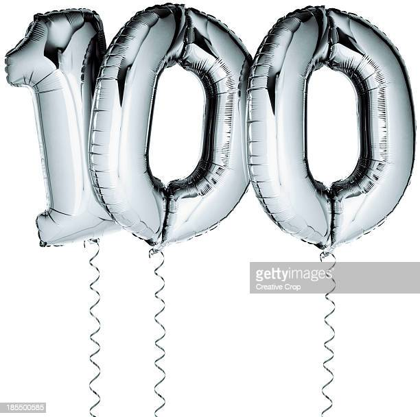 Silver balloons in the shape of a number 100