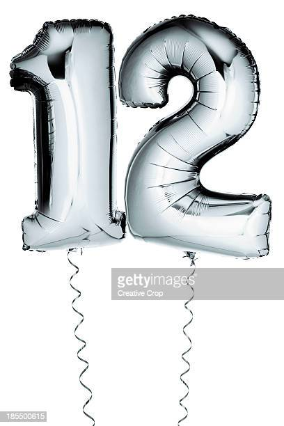 Silver balloons in the shape of a number 12