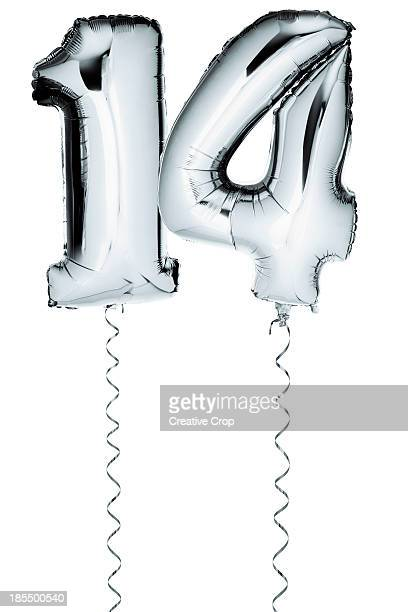 Silver balloons in the shape of a number 14