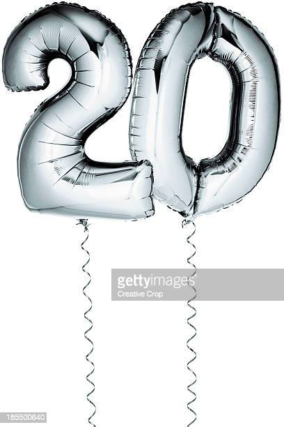 Silver balloons in the shape of a number 20