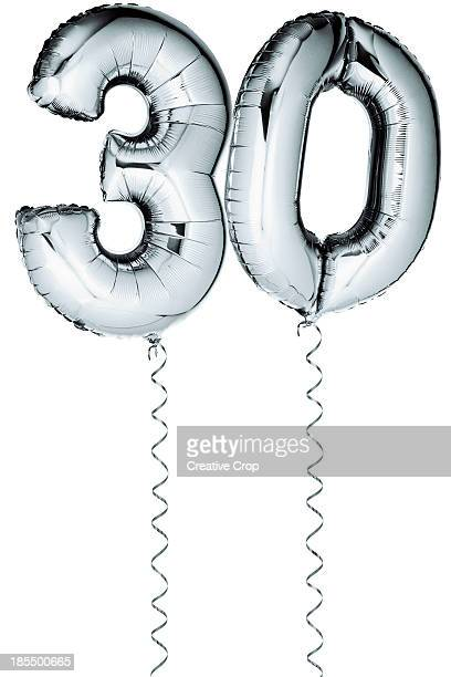 Silver balloons in the shape of a number 30