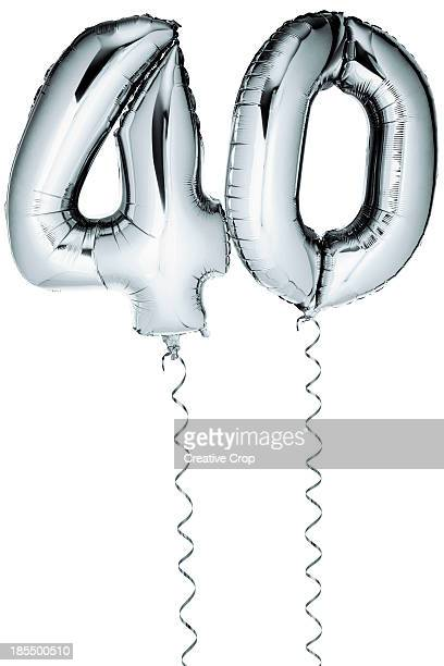 Silver balloons in the shape of a number 40