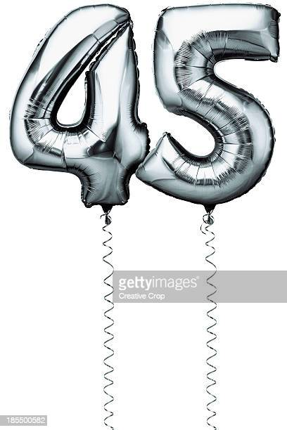 Silver balloons in the shape of a number 45