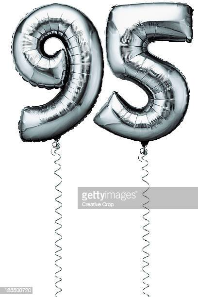 Silver balloons in the shape of a number 95