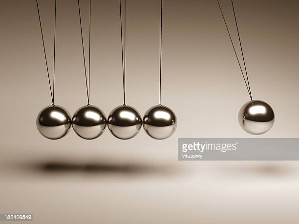 Silver balls on strings in a Newton's cradle
