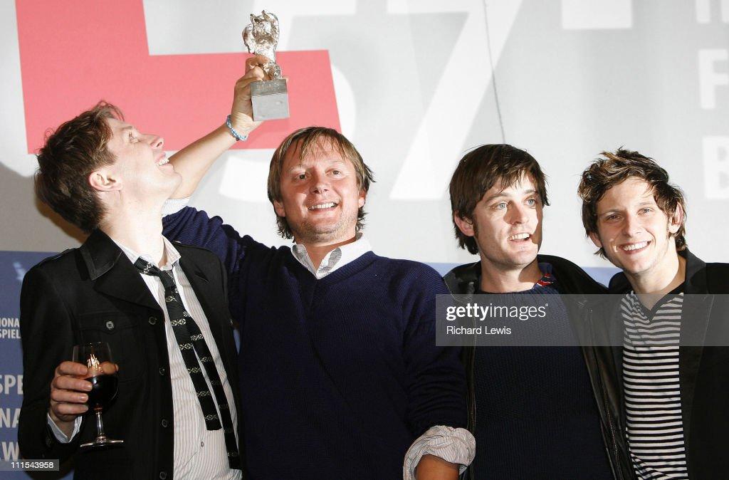 Silver Bear winner Director David Mackenzie holds up his award from left Alex Kapranos Jamie Bell and Nick McCarthy