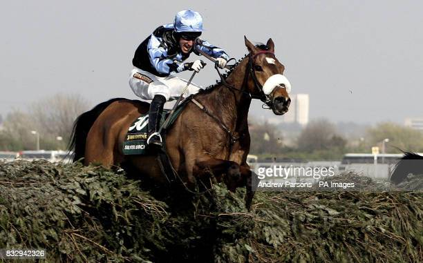Silver Birch ridden by jockey Robbie Power jumps the last on the way to winning the The John Smith's Grand National Steeple Chase at Aintree...