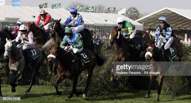 Silver Birch ridden by Robbie Power jumps over the chair on his way to winning the The John Smith's Grand National at Aintree Racecourse Liverpool