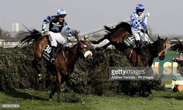 Silver Birch ridden by Robbie Power jumps the last ahead of Slim Pickings ridden by Barry Geraghty on the way to winning the The John Smith's Grand...