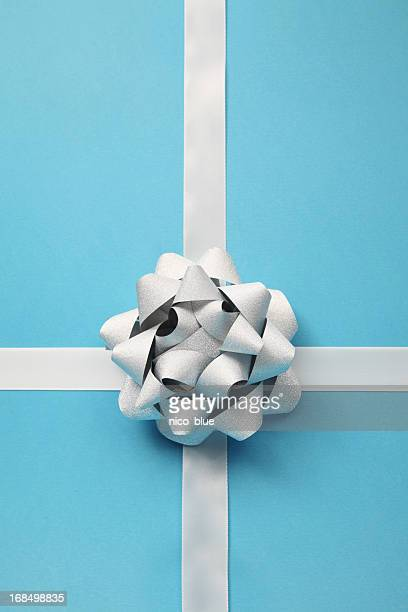 Silver bow on blue