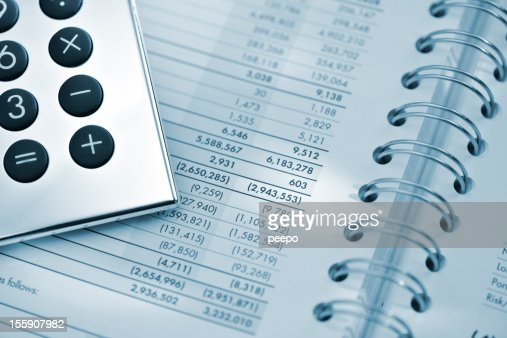 silver calculator on sheet of financial data