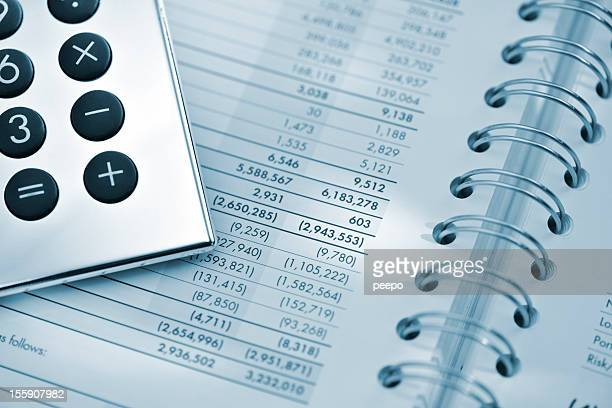 silver calculator on sheet of financial data