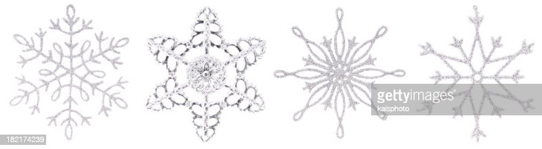 Silver Christmas snowflakes in a row.
